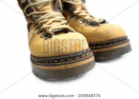 Closeup of yellow boots isolated on white background