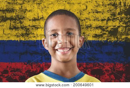 Black child against the flag of Colombia