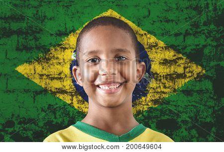 Black child against the flag of Brazil
