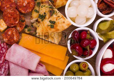 Antipasto Sharing Platter A large wooden sharing platter of Antipasto