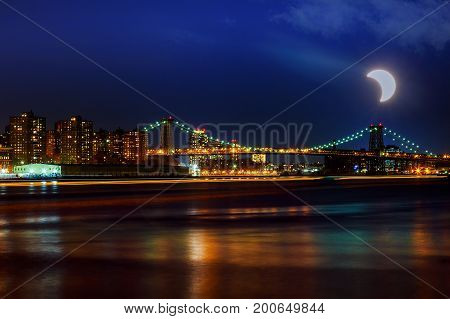 Solar Eclipse, New York Ny August 21 2017Williamsburg Bridge At Dusk Spanning The East River