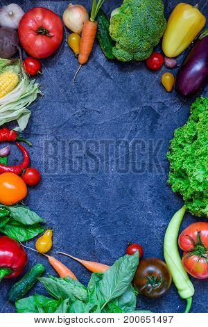 Frame Of Organic Food. Fresh Raw Vegetables And Greens On The Dark Concrete Background. Healthy Life