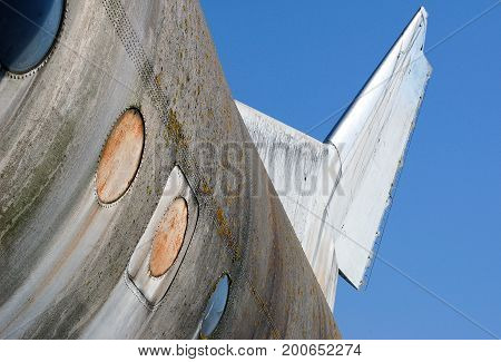 Old abandoned airplane, detail of windows and vertical stabilizer