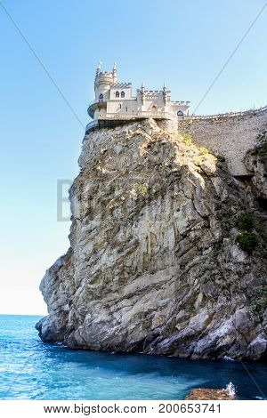 The castle is on top of a rocky cliff. Small Castle Lastochkino Nest and its surroundings.