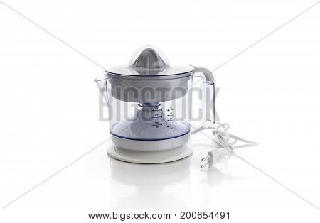 Electric citrus juicer on a white background closeup