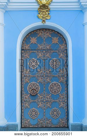 Ancient door to the Christian church. Architecture