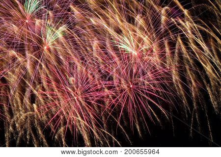 Bright flowing stream of fireworks. Colored firework background for all festive occasions