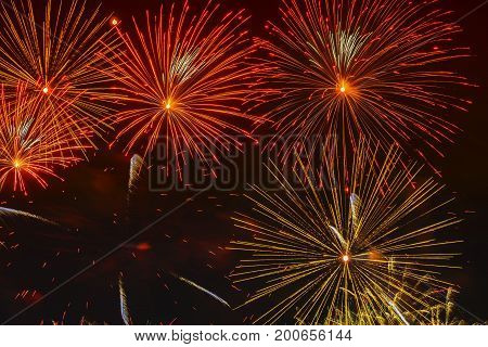 Bright golden glowing spheres and flickering stars, fireworks. Elegant background for all festive occasions. New Year, Independence Day, all festive occasions, beautiful festive background with free space for text
