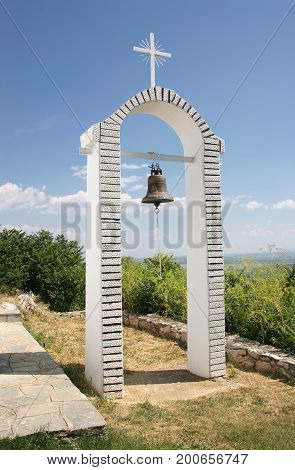 Bell tower on the hill above Lake Orestida. Kastoria. Greece