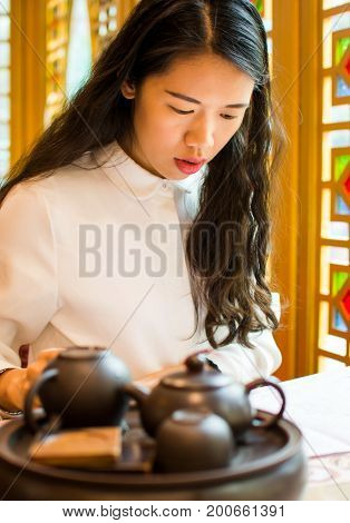 Girl Reading Menu At Chinese Restaurant