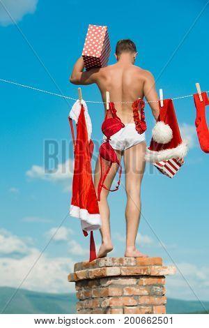 Christmas Man Hold Present Box.