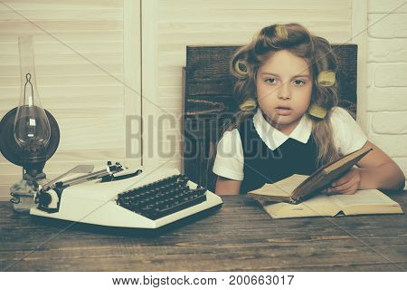 Little Baby Secretary With Typewriter And Book.