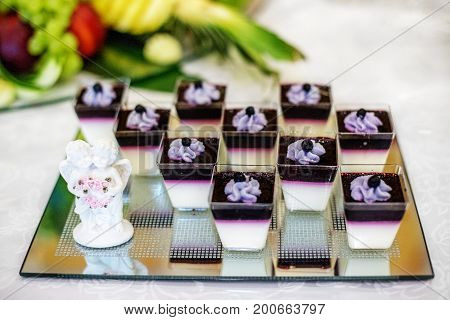 Many blueberry desserts on glass. The concept of food restaurant cafe bar Candy holiday.