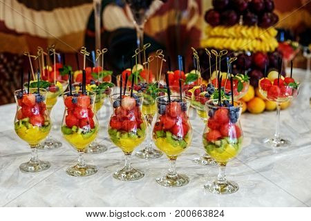 Fruit portions of desserts. The concept is healthy food holiday restaurant catering.