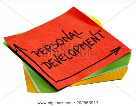 personal development - handwriting in a black ink on isolated sticky note