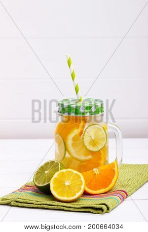 Detox fruit infused flavored water. Lemon, lime and orange. Refreshing summer homemade cocktail