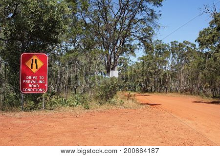 Drive to prevailing road conditions sign on the way to Cape York Australia