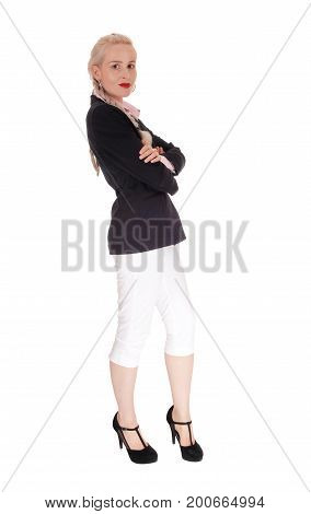 A beautiful tall blond business woman standing in a black jacked and white pants in profile with braided hair isolated for