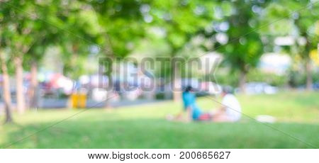 Blurred people activities at park background wellness spring and summer season