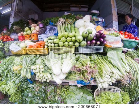 HO CHI MINH CITY, VIETNAM - JULY 25, 2017:  Women selling vegetables at the Ben Thanh market in Saigon (Ho Chi Minh City), Vietnam