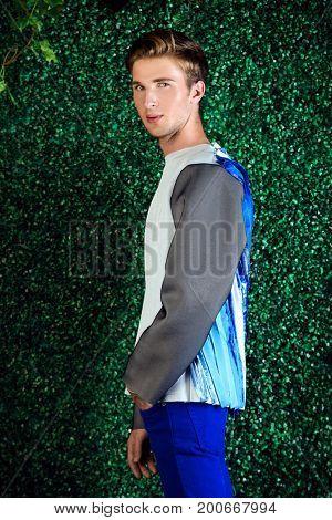Portrait of a handsome fashion model posing in designer clothes. Fashion shot.