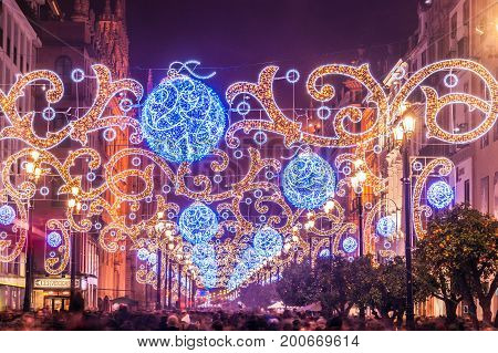 Night view of the principal avenue of Seville illuminated with lights for Christmas