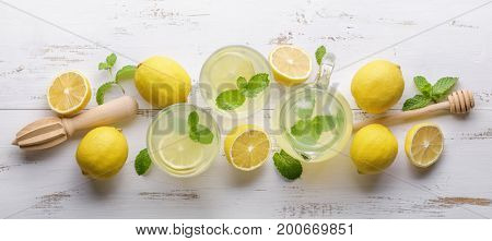 Lemon and juice on wooden background