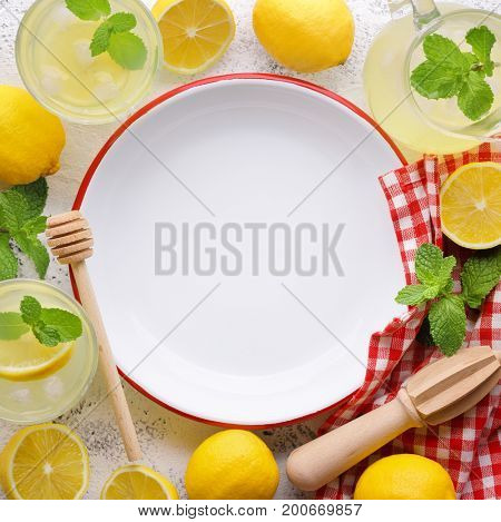 Lemon and juice with empty plate