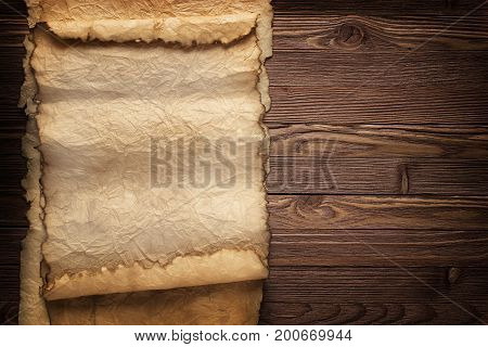 Old Paper On A Table, Background Of Ancient Scrolls And Plank