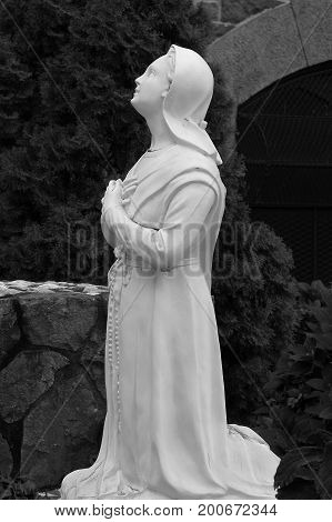 New York USA - September 27 2016: Close up image of a Shepherd Child praying to the Blessed Mother Mary Our Lady of Fatima at the Shrine of Saint Anthony Church in Soho.