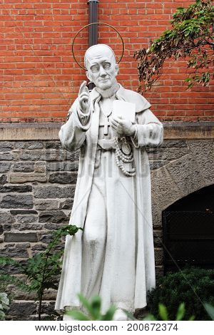 New York USA - September 27 2016: Statue of Saint Alphonsus outside the church of St Anthony of Padua located in Greenwich Village Manhattan.