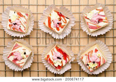 Vanilla cream cake arranged on cooking rack,delicious dessert
