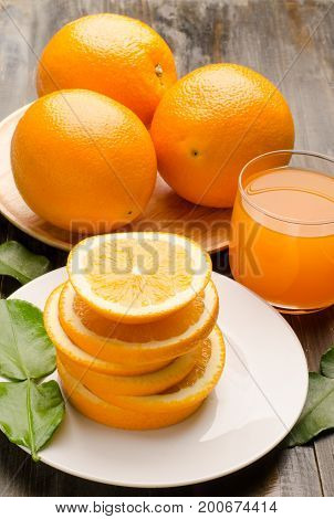 Slices Navel orange fruit and juice on wooden background,Healthy food