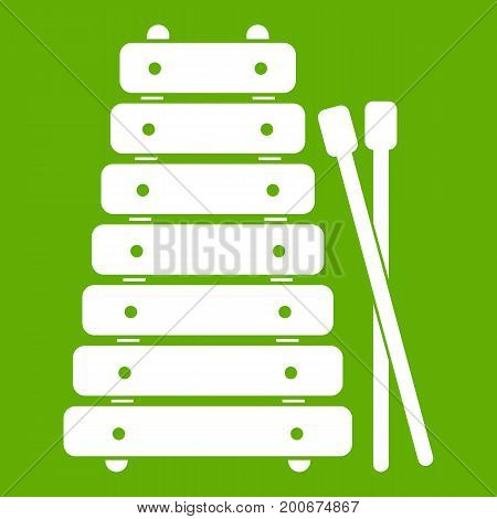 Xylophone and sticks icon white isolated on green background. Vector illustration