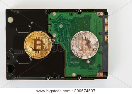 Bitcoin coin on the HDD background