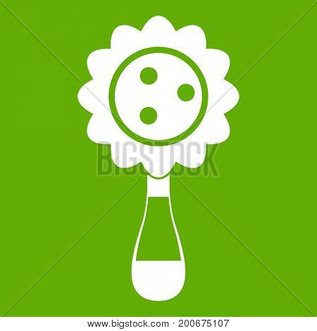Rattle baby toy icon white isolated on green background. Vector illustration