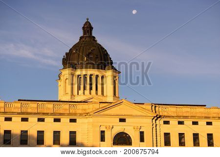 The moon shines behind the capitol dome in Pierre SD