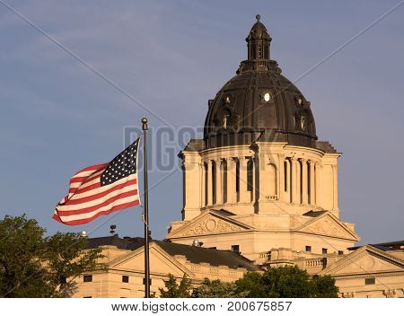 The American Flag waves in front of the capitol dome in Pierre SD