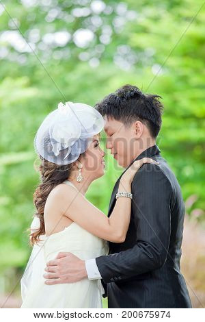 Portrait of Romantic Newlyweds Couples kissing for wedding background