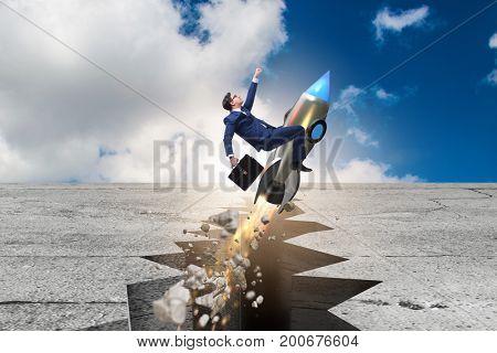 Businessman flying on rocket from rock gap