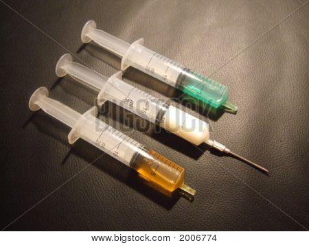 Three Syringes