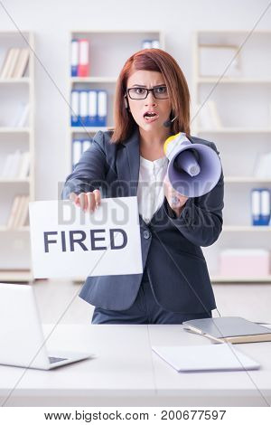 Businesswoman firing people in office