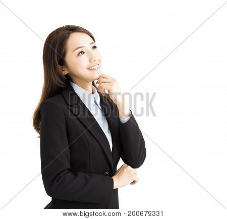 smiling business woman thinking and looking up