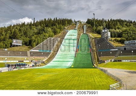 LILLEHAMMER NORWAY - AUGUST 2 2016: Ski jump near Oslo known as Lysgardsbakken opened in 1993 specifically to the XVII Olympic Winter Games in 1994. Now the centre of winter sports in Norway.