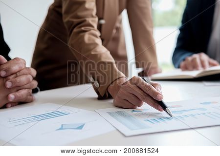 Attractive Meeting At Nonprofit Boardroom Group Of Employees At Conference Table Workers Collaborate