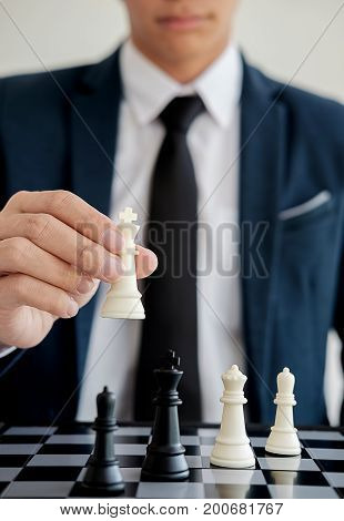 Hand of a business making a chess movement. Business concept strategy leadership team and success