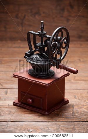 Vintage coffee mill on rustic old wooden table