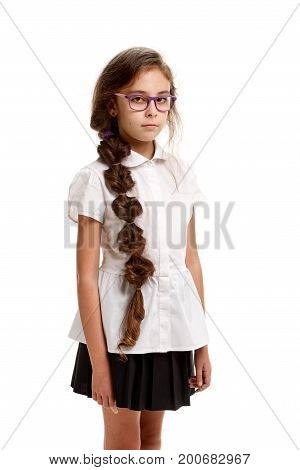 Portrait of young beautiful girl in school uniform