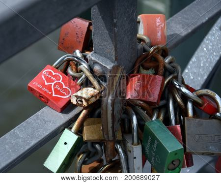 Frankfurt am Main Germany - Aug 2 2017. Thousands of couples showing their everlasting love by attaching a coloured padlock to the Eiserner Steg iron bridge as a token of love.