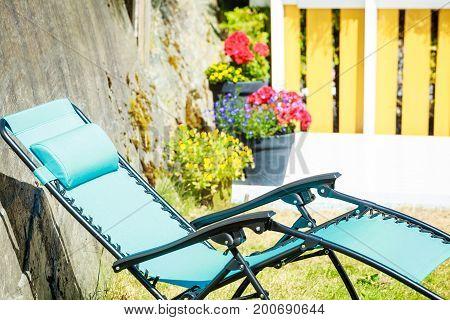Blue Sunbed Deck Chair In Garden